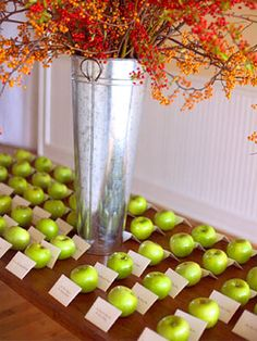 Seating arrangement for apple themed wedding.
