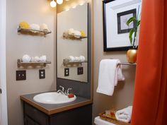 Stainless steel towel racks bring creativity when storing toiletries. Rather than housing linens, these wracks hold loofahs, sponges and clear canisters of cotton balls.