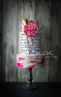 White and pink cake with writing