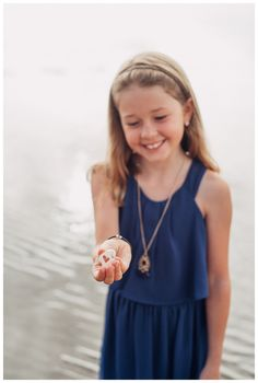 Young girl holding a shell with a cut out heart in Tamarindo Costa Rica. Costa Rica kids, Costa Rica family, Costa Rica family vacation, costa rica yoga, Costa Rica vacation, Costa Rica beach, Costa Rica things to do, Costa Rica travel, Costa Rica photography, Costa Rica photographer, Costa Rica Tamarindo Costa Rica Guanacaste, Costa Rica Pura Vida, Costa Rica tips, pura vida, Costa Rica tips, Tamarindo Costa Rica Photographer, Guanacaste Costa Rica Photographer,