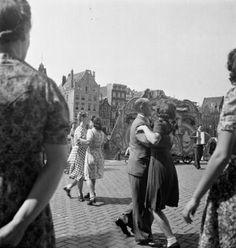 Dancing on music of a Barrel Organ, celebrating the ending of WW II in Amsterdam, 1945 by Cas Oorthuys
