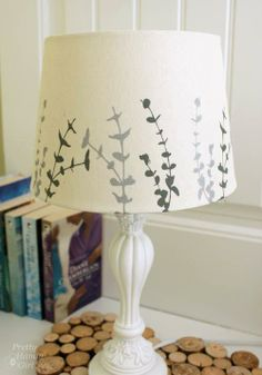 Painting a lampshade is a quick and inexpensive way to update a guest bedroom.