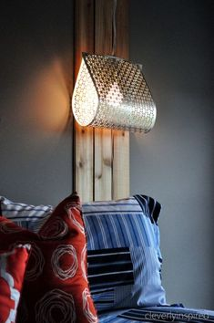 Tracie at Cleverly Inspired bent metal sheets (typically used as vent covers) into inventive lamps that are anything but girly — they flank her preteen son's bed. Get the tutorial here »