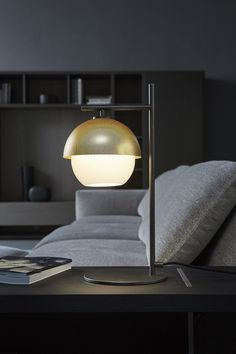 Portable Fixtures, Table:   This lamp acts as task lighting, allowing people to read on the couch even when the surrounding general lights are turned off.