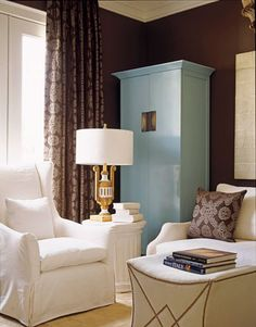Media room with antique robin's egg blue armoire.   Curtains are Donghia's Omen Damask in hemlock-dark brown.