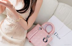 Oh my pink sparkle dress with a pink Dior bag!