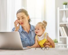 mother with toddler working by choreograph. Young mother with toddler child working at the computer, talking on the phone at home. Qigong, Stress Management, Kids Computer, Daughters Day, Technology Photos, Marca Personal, Working Woman, Working Mother, Kids Wallpaper