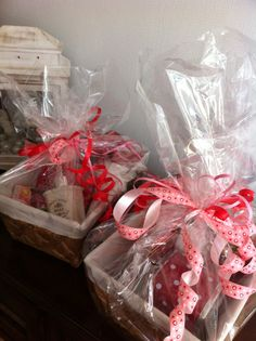 So I made two Mother's Day baskets filled with chocolate, small gifts and feel goodies! Wrapped with cellophane and pink & red bows