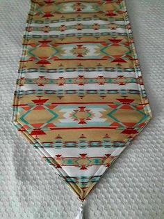 Beautiful Southwestern Reversible Table Runner. Padded and machine washable