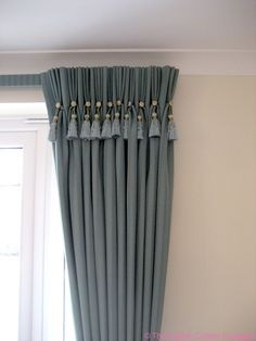 Grey triple pleat curtains with buttons and key tassel detail. Fabulous!