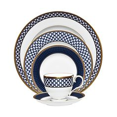 Modern elegance takes center stage in Noritake's mesmerizing Blueshire Dinnerware. Repeating vertical and horizontal diamond patterns in rich shades of blue dazzle on bone china while textured gold banding adds a sophisticated, luxurious touch.