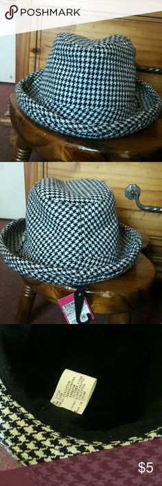 749e69407edc4 Shop Women s Xhilaration White Black size OS Hats at a discounted price at  Poshmark. Description  White and black printed fedora.