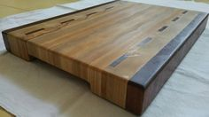 End grain butcher block/cutting board engraved handles and non slip rubber feet. materials: oak,ash,mahogany, food safe water resistant glue, mineral oil & bee wax. Dimensions: 11 / 15/ 1.25 inch = 380/ 280/ 40 mm