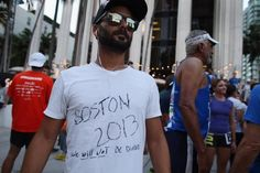 MIAMI, FL - APRIL 16: Runner Michael Zapelini wears a shirt where he wrote, Boston 2013 We Will Not Be Divided, as the Baptist Health South Florida Brickell Run Club honors the victims of the Boston Marathon bombings on April 16, 2013 in Miami, Florida. The event drew approximately 1,000 people who wanted to honor the three people killed in the Boston bombing as well as the over one hundred who were injured. (Photo by Joe Raedle/Getty Images)