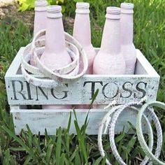 Paint the bottles to look like fingers and spray paint the rings with sparkles! :D