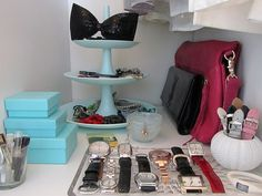 pretty organization for the closet... great tiered cake stands for display!(love that they are in Tiffany's blue).