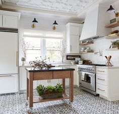 "Striking ""Seville"" pattern from Veranda Tile, shown in a airy kitchen in Napa, CA."