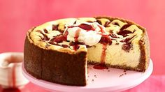 Zesty, creamy cheesecake with a plum topping, served with whipped cream and plum syrup.