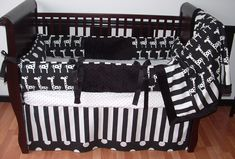 Ivan Black & White Crib Set  This custom 3 pc baby crib bedding set includes, bumper pad, crib skirt, and blanket.  The black and white designer prints in stripes dots and giraffe, black grosgrain ties, and ultra soft black minky combine softness and texture. The best for your little angel's nursery. BOY or GIRL!