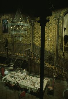 ripped curtains, faded wallpaper, epic chandelier, cobwebs: gorgeous