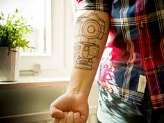Camera Tattoo. If you love being behind the camera, you can go for a tattoo of a camera. You have endless options with your tattoo.