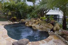 Google Image Result for http://www.lucaslagoons.com/images/SWIMMING-POOLS-LAGOONS/farley/1-500-spool-pool-spa-farley.jpg