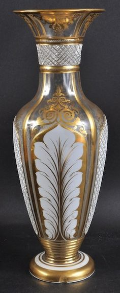 A Bohemian White Overlay And Gilt Vase