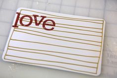 "love this from ae.  it's a new product at designer digitals...thick lined journaler that you can print and add your own handwriting (""love"")."