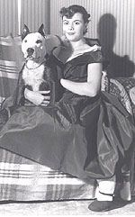 """Everyday and Forever, """"pit bull"""" dogs are family: 1950s photograph of a woman with her dog."""