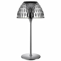 Estiluz E-Llum Table Lamp - M-5656/M-5657 by Estiluz. $1100.00. The Estiluz E-LLUM M-5656 Table Lamp has a contemporary look that will add beauty and style to your decor. The E-LLUM M-5656 Table Lamp features White satin glass shade, metal body and Matte Nickel finish.Estiluz, established in 1969, is a co