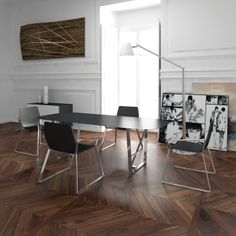 This is the living room furnished with Hexa chairs and the Martin table.