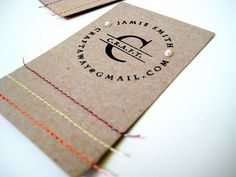 creative business cards made of cereal box cardboard, thread pattern, and a stamp!