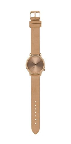 New and popular Komono watch with a leather wristband for women. The Estelle watch matches not only your outfit but your entire personality.