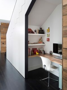 Under the stairs - convenient and uses up often forgotten space.