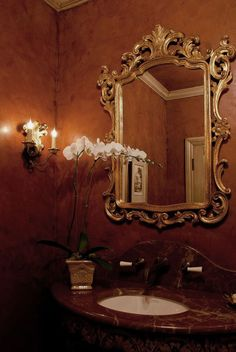 Luxurious powder room with 18th century style Venetian style mirror; luxury bathroom inspiration; powder room ideas