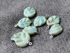Hey, I found this really awesome Etsy listing at https://www.etsy.com/listing/257759480/lampwork-leaves-beads-set-4-psc-leaf