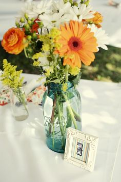 love the mason jar of course but the little picture frames with the table numbers are presh