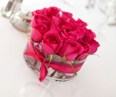 small rose centerpieces for weddings | the one stem centerpiece since the cost of wedding centerpieces