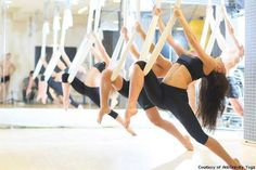 You can do it while you dance, you can do it wearing pants! You can do it with a rope, you can do it on a slope! Hybrid yoga is the hottest trend, here's cool new ways your bod can bend!