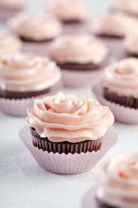 Dark chocolate cupcakes with cherry buttercream frosting.