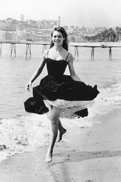 Brigitte Bardot in Cannes, France, 1956. See 51 more rare, vintage photos of celebrities enjoying summer.