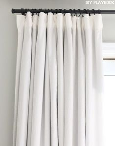 We finally have some window treatments in our bedroom. Here's how to DIY no-sew blackout curtains.