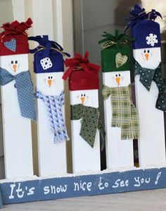 Make these cute snowmen using 2x4s, scrap fabric and paint.
