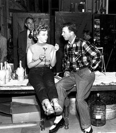 Dan Dailey visits Marilyn Monroe on the set of Clash by Night, 1952, directed by Fritz Lang.