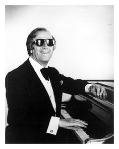 """Sir George Shearing, OBE (13 August 1919 – 14 February 2011) was a British jazz pianist who for many years led a popular jazz group that recorded for Discovery Records, MGM Records and Capitol Records. The composer of over 300 titles, including the jazz standard """"Lullaby of Birdland"""", he had multiple albums on the Billboard charts during the 1950s, 1960s, 1980s and 1990s.  He died of heart failure in New York City, at the age of 91."""