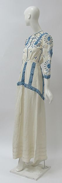 Dress ca. 1910, Culture: British; Medium: linen, cotton -  long white dress with sky blue embroidery and lacy crochet flower square details (hva)