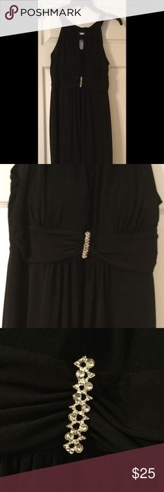 Little Black Dress Worn once to a wedding, excellent condition!!! Beautiful  rhinestone detail. Has built in padded bra. Hits above the knee. Dresses