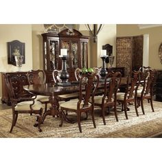 The American Cherry Fredericksburg Dining Table inspired by original pieces of American built antiques brings a modern feel to classic pieces in your home. Add beauty and sitting space to your dining room, includes two leaves extending to 126 inches. Built from solid walnut, finished with highly figured cherry veneers, and elegant pedestal bases add classic beauty to your home.