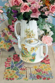 Embroidery, teapot with a cottage, coffee pot with daisies.... my favorites!
