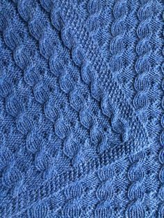 Free Knitting Pattern for Reversible Cable Baby Blanket - Suzanne Bryan's baby blanket is reversible and the cables can be knit without a cable needle. Pattern includes cable flare compensation to keep the ends of the blanket flat.